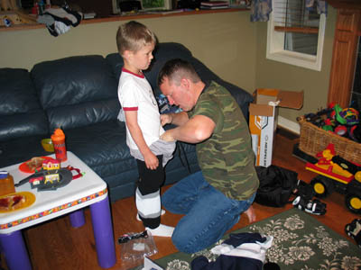 Dad getting Connor dressed.